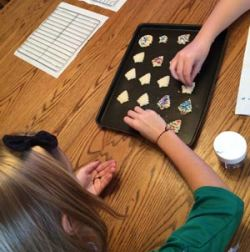 Grace and her friend decorating gluten-free spritz cookies earlier this month.